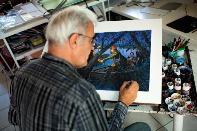 Jean-Pierre Gibrat met la dernière touche à un des dessins vendus aux enchères par Christie's.