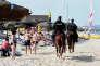 A Hammamet, en juin. Pour restaurer la confiance des touristes, la sécurité a été renforcée, la police patrouille sur les plages et les hôteliers ont musclé leur dispositif.