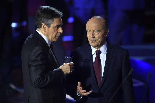 François FIllon et Alain Juppé lors du deuxième débat télévisé de la primaire, le 3novembre.