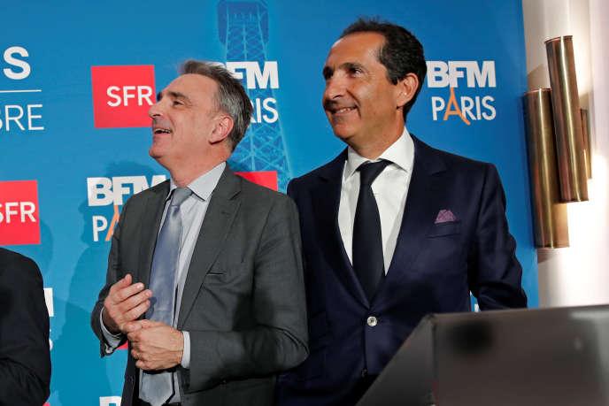 Michel Paulin (gauche), alors PDG de SFR Telecom et Patrick Drahi (droite), PDG d'Altice, au lancement de la chaîne de télévision BFM-TV en novembre2016.