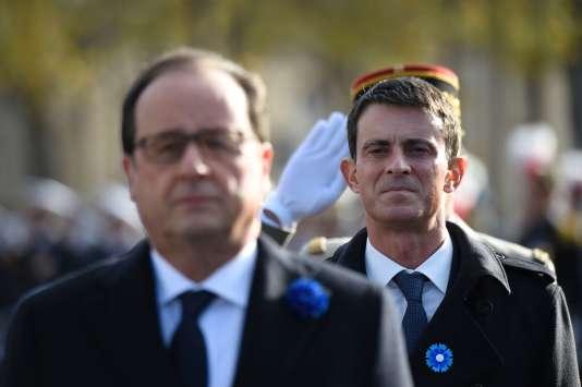François Hollande et Manuel Valls, lors des cérémonies commémorant l'Armistice, à Paris, le 11 novembre.