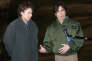 French ex-hostages Christian Chesnot (L) and Georges Malbrunot (R) answer journalists questions upon their arrival at Villacoublay airforce base near Paris 22 December 2004. Christian Chesnot and Georges Malbrunot were freed 21 December in Baghdad after 124 days of captivity. AFP PHOTO JACK GUEZ / AFP PHOTO / JACK GUEZ