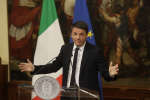 Italian Premier Matteo Renzi speaks during a press conference at the premier's office Chigi Palace, early Monday, Dec. 5, 2016. Renzi acknowledged defeat in a constitutional referendum and announced he would resign on Monday. Italians voted Sunday in a referendum on constitutional reforms that Premier Matteo Renzi has staked his political future on. (AP Photo/Gregorio Borgia)