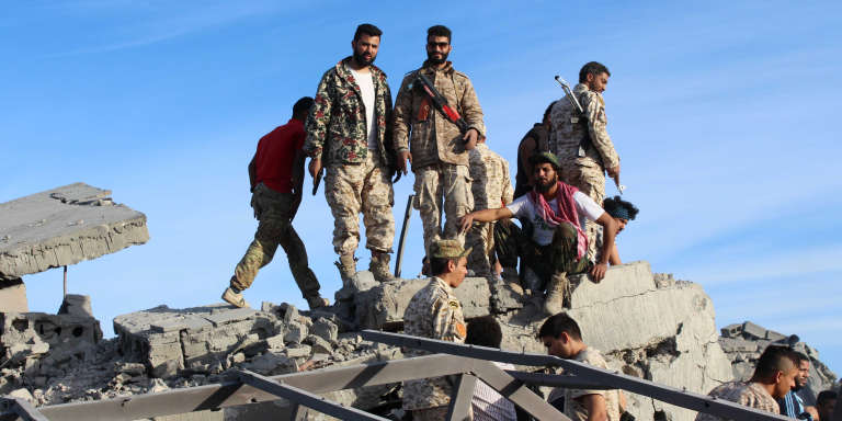 Fighters of Libyan forces allied with the U.N.-backed government gather atop the ruins of a house as they are close to securing last Islamic State holdouts in Sirte, Libya December 5, 2016.