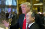 Donald Trump et Masayoshi Son, le patron de SoftBank, dans le hall de la Trump Tower, le 6 décembre à New York.