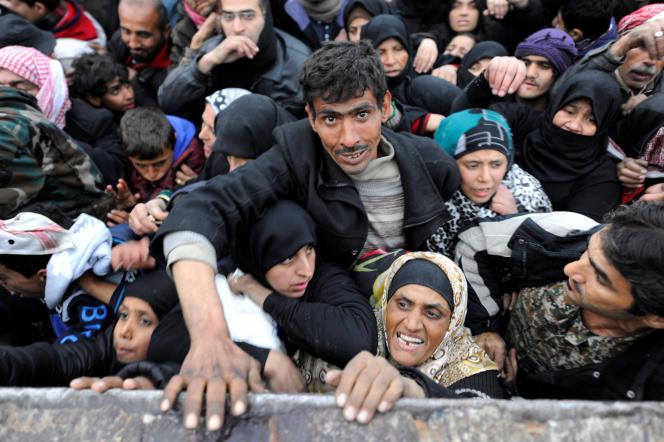 «C'est donc sur l'autel de l'irrédentisme kurde et du djihadisme transnational que la révolution populaire syrienne a été très égoïstement sacrifiée» (Photo: Syriens évacués de l'est d'Alep, le 30 novembre).