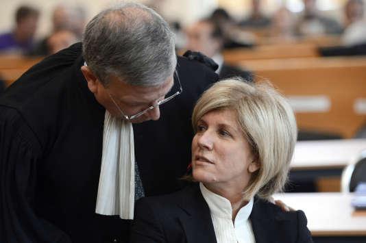 Sylvie Andrieux avec son avocat, maîtreDi Marino, avant le début de son procès au tribunal de Marseille, le 12 mars 2013.