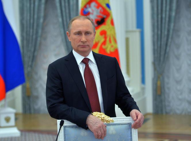 2803401 03/08/2016 March 8, 2015. Russian President Vladimir Putin delivers a message of congratulation to Russian women on the International Women's Day. Alexei Druzhinin/Sputnik