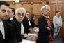 Christine Lagarde accompagnée de ses avocats devant la Cour de justice de la République à Paris le 12 décembre.
