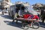 Des personnes évacuant Alep-Est, en Syrie, le 15 décembre 2016