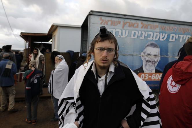 Un jeune colon israélien, à l'avant-poste d'Amona en Cisjordanie occupée, le 18 décembre.