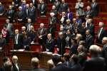 Les députés observent une minute de silence à l'Assemblée en hommage aux victimes de l'attentat de Berlin, le 20 décembre 2016.