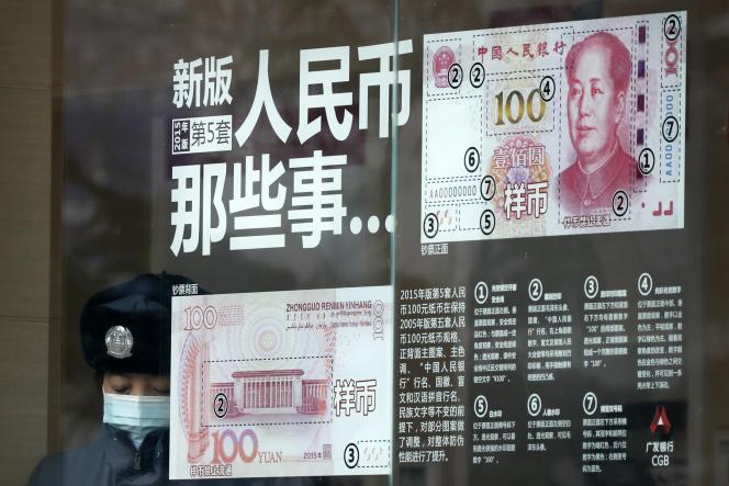 Sur la vitrine d'une agence bancaire, le 1er janvier, à Pékin.