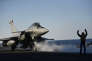 A Rafale fighter jet takes off from the deck of France's Charles de Gaulle aircraft carrier, used in the U.S.-led operation against Islamic State group in Syria and Iraq in the eastern Mediterranean Sea, Friday, Dec. 9, 2016. (Stephane de Sakutin, Pool Photo via AP)