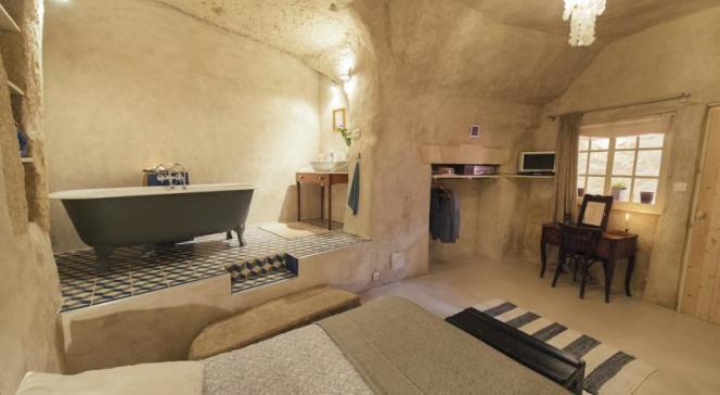 Une ancienne « grotte» devenue chambreà l'atmosphèreraffinée.
