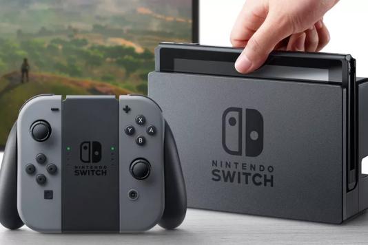 La Nintendo Switch et sa manette, façon « console de salon». Elle peut également s'emporter et s'utiliser de manière nomade.
