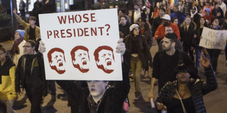 CHICAGO, IL - NOVEMBER 09: Demonstrators protest on Michigan Avenue November 9, 2016 in Chicago, Illinois. Thousands of people across the United States took to the streets in protest a day after Republican Donald Trump was elected president, defeating Democrat Hillary Clinton.   John Gress/Getty Images/AFP == FOR NEWSPAPERS, INTERNET, TELCOS & TELEVISION USE ONLY ==