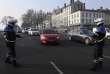 Des policiers contrôlent les véhicules circulant à Lyon, le 23 janvier.