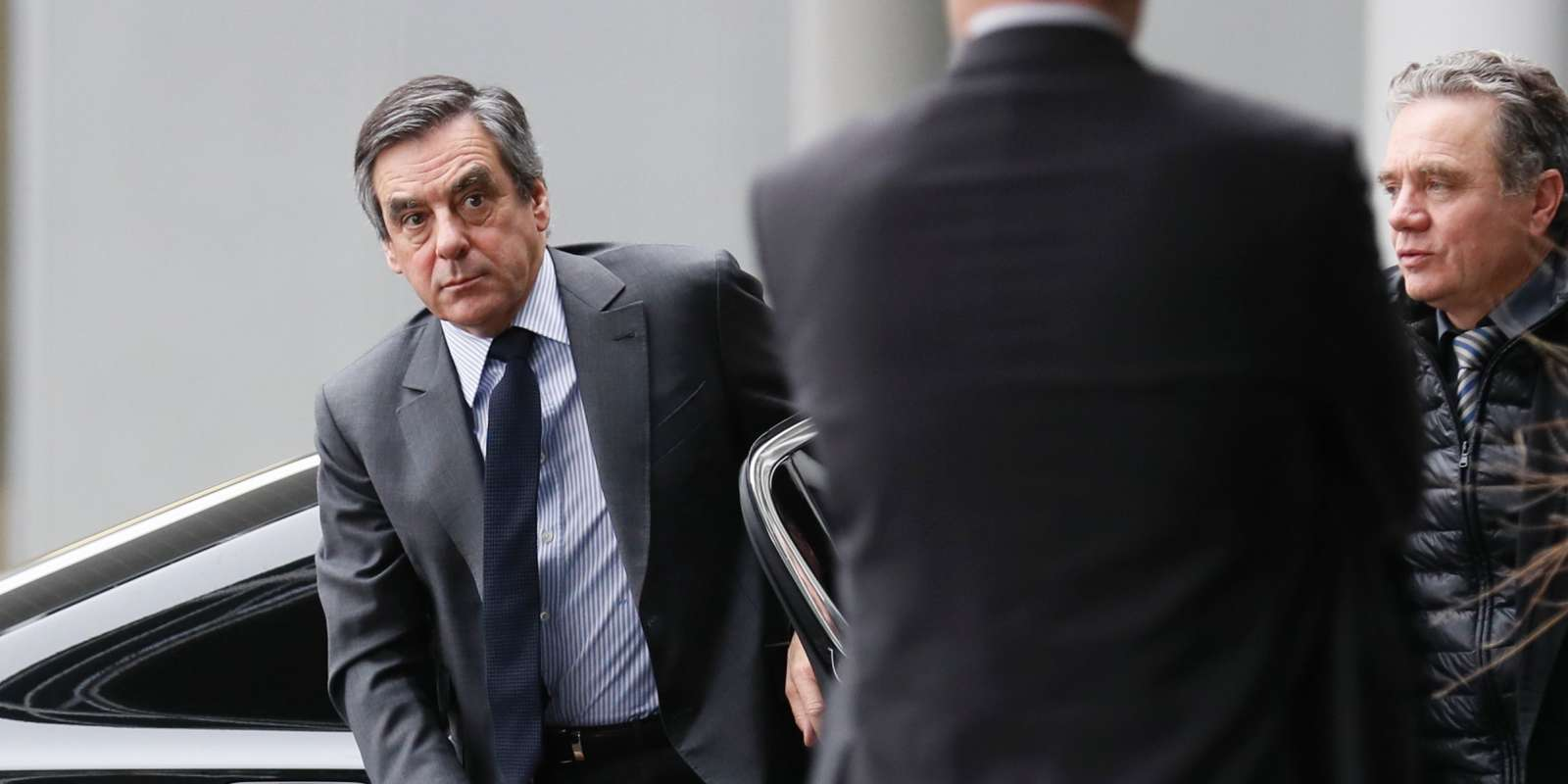 Former French Prime minister and right-wing candidate for the upcoming presidential election Francois Fillon (L) arrives to attend the opening ceremony of the archives of late French political figure Philippe Seguin, on January 26, 2017 at the Archives Nationales in Pierrefitte-sur-Seine. Under-fire French presidential candidate Francois Fillon on January 26, 2017, responded to claims that his wife had been paid 500,000 euros ($540,000) for a fake job by saying she has