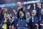 France's Nikola Karabatic celebrates with the trophy after winning the Handball World Championship final match between France and Norway at the Bercy arena in Paris, Sunday, Jan. 29, 2017. France won 33-26. (AP Photo/Michel Euler)