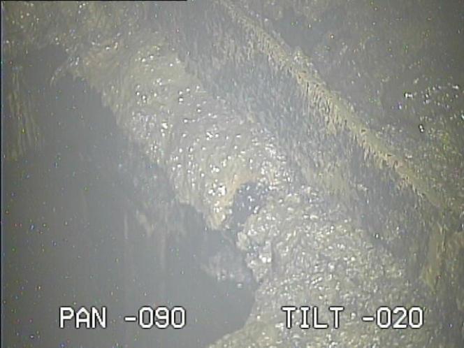 Les images prises par la caméra insérée dans le réacteur2 de la centrale de Fukushima (Japon) montrant un trou, le 30janvier 2017.