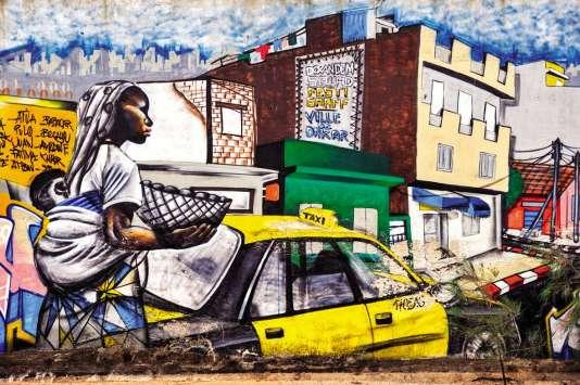 Peinture murale collective dans le quartier de la Médina.