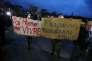 Des manifestants brandissent des pancartes pendant la visite de François Fillon à la médiathèque du Grand Troyes, le 7 février.