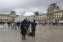 Journalistes devant le musée du Louvre, à Paris, le 4 février, au lendemain de l'attaque de deux militaires à la machette.