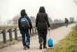 Migrants marchant le long d'une route menant à Calais, le 9 février.