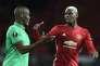 Le défenseur de Saint-Etienne Florentin Pogba et son frère cadet Paul, au terme de la rencontre des Verts et Manchester United en 16es de finale de Ligue Europa, le 16février 2017. Manchester United a remporté le match (3-0).