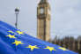 """An European Union flag blows in the wind in front of the Elizabeth Tower, better known as """"Big Ben"""", near the Houses of Parliament during a """"Flag Mob"""" demonstration in Parliament Square in central London on February 20, 2017, part of a national day of action in support of migrants in the UK. Under the banner 'One Day Without Us' men, women and children come together for a day of action to stress that they want Britain to remain open and welcoming. A number of businesses closed for the day to make the point that the Britain couldn't manage for even one day without the contribution of migrants. / AFP PHOTO / Justin TALLIS"""
