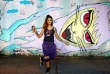 """Mado, 34, a Brazilian artist, poses for a photograph in front of her artwork at Vila Madalena neighbourhood in Sao Paulo, Brazil, February 23, 2017. """"Once a company did not want to hire me to paint a mural because they said that women could not carry the work material (paint boxes, ladders),"""" Mado said. """"I believe that things will only get better for all of us if men treat women equally."""" REUTERS/Nacho Doce SEARCH """"WOMEN WORK"""" FOR THIS STORY. SEARCH """"WIDER IMAGE"""" FOR ALL STORIES."""