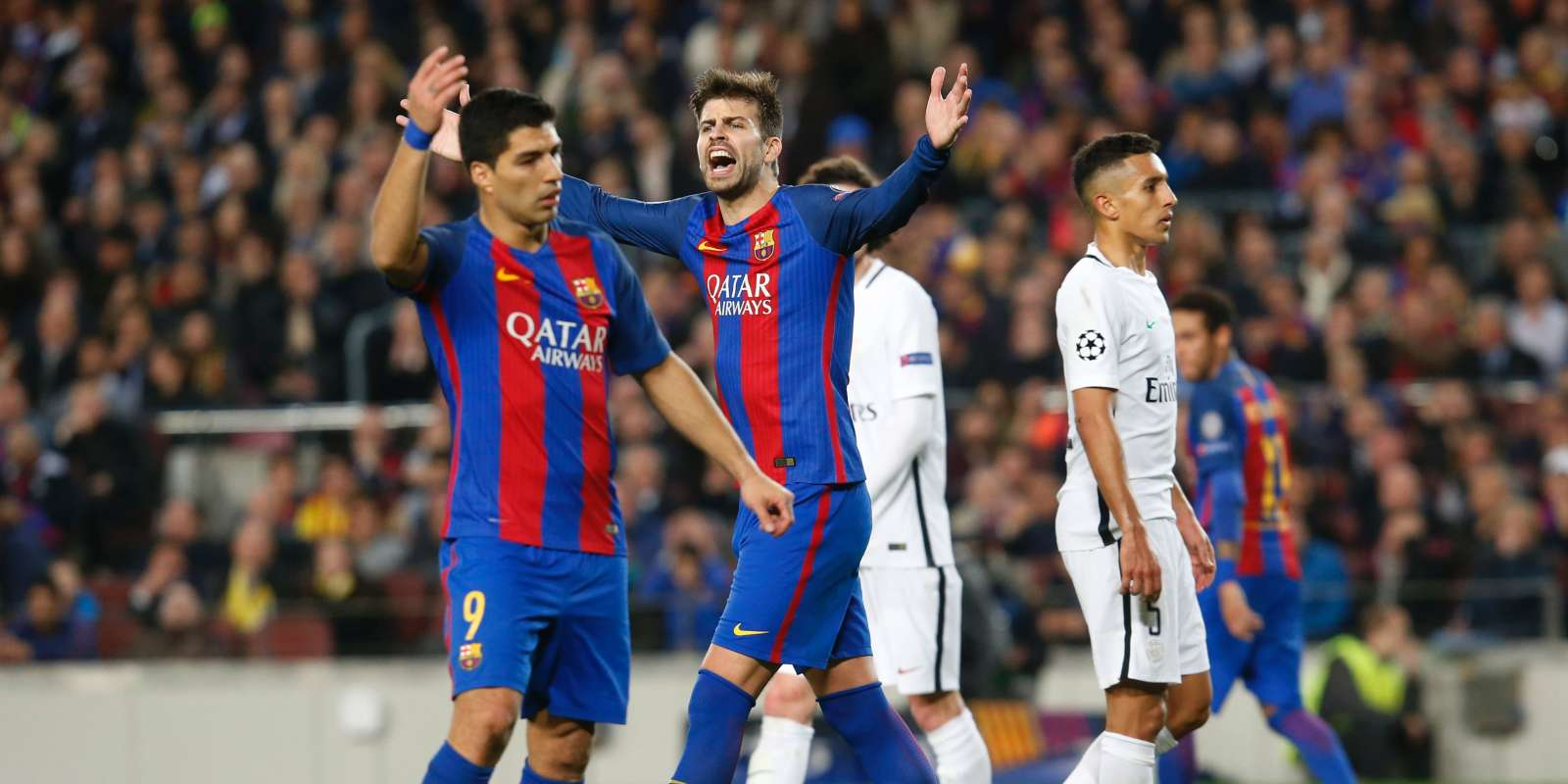 Barcelona's defender Gerard Pique (C) and Barcelona's Uruguayan forward Luis Suarez react to a decision of the referee during the UEFA Champions League round of 16 second leg football match FC Barcelona vs Paris Saint-Germain FC at the Camp Nou stadium in Barcelona on March 8, 2017. / AFP / PAU BARRENA