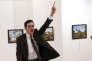 "ILE - In this Monday, Dec. 19, 2016 file photo Mevlut Mert Altintas shouts after shooting Andrei Karlov, right, the Russian ambassador to Turkey, at an art gallery in Ankara, Turkey. Associated Press photographer Burhan Ozbilici won the 2017 World Press Photo competition Monday Feb. 13, 2017 for the image. It was part of a series titled ""An Assassination in Turkey"" which also won the Spot News - Stories category, captured in the moments before and after Altintas, an off-duty policeman, drew a handgun and shot Karlov at a photo exhibition. (AP Photo/Burhan Ozbilici, File)"