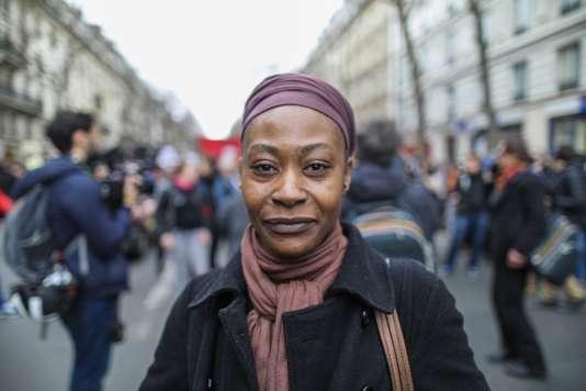 Dans le cortège de La Marche pour la justice et la dignité défileRamata Dieng, la sœur de Lamine, mort au cours d'une intervention policière, dimanche 19 mars.