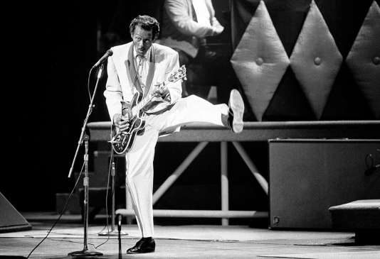 FILE - In this Oct. 17, 1986 file photo, Chuck Berry performs during a concert celebration for his 60th birthday at the Fox Theatre in St. Louis, Mo. On Saturday, March 18, 2017, police in Missouri said Berry has died at the age of 90. (AP Photo/James A. Finley)