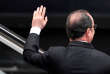 French President Francois Hollande waves during his visit at the Cite des Sciences as part of the launch of French strategy in artificial intelligence in Paris, France, March 21, 2017. REUTERS/Stephane de Sakutin/Pool