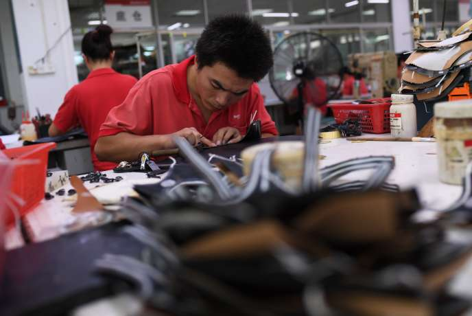 Une usine de chaussures de Dongguan, dans la province du Guangdong, dans le sud de la Chine, le 14 septembre 2016.