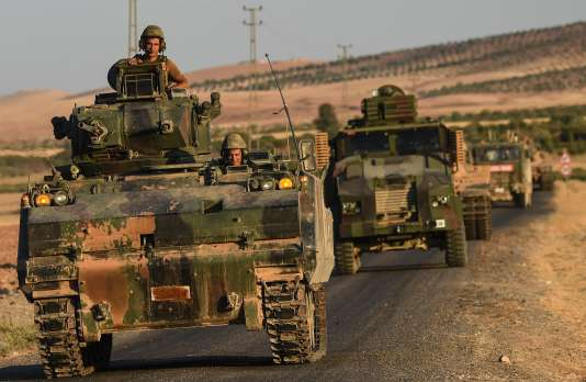 (FILES) This file photo taken on September 02, 2016 shows Turkish soldiers driving back to Turkey from the Syrian-Turkish border town of Jarabulus. Turkey on March 29, 2017 announced its military campaign inside northern Syria was over, without specifying whether it will pull its troops out from the neighbouring country. / AFP / BULENT KILIC
