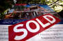 FILE PHOTO: A real estate agent's sign outside a house shows that it has recently been sold, in Sydney September 30, 2014.  REUTERS/David Gray/File Photo