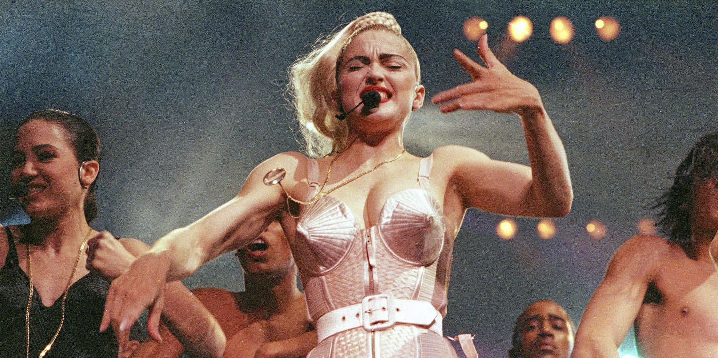 """FILE - In this June 4, 1990 file photo, pop singer Madonna performs with her dancers during her Blond Ambition tour in Worcester, Mass. """"Strike a pose,"""" a new documentary that follows the dancers that accompanied Madonna on her 1990 """"Blond Ambition"""" tour, will debut on the Logo channel on Thursday, April 6, 2017. (AP Photo/Sandy Hill, File)"""