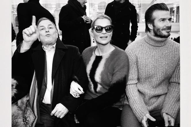 Michael Burke (à g.), PDG de Louis Vuitton, avec Kate Moss et David Beckham, au premier rang du défilé Vuitton au Palais-Royal, le 19janvier dernier, à Paris.