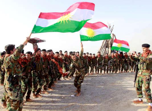 Des membres des peshmergas à Kirkouk, le 20 mars.