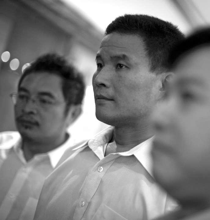 Washington, le 4 juin 2009. Yu Zhijian, entre Yu Dongyue (à gauche) et Lu Decheng.