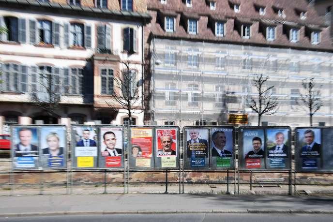 A Strasbourg, le 10 avril 2017, affiches des onze candidats à la présidentielle.