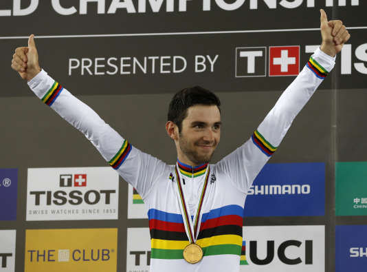 France's Benjamin Thomas celebrates on the podium after winning the men's omnium at the World Track Cycling championships in Hong Kong, Saturday, April 15, 2017. (AP Photo/Kin Cheung)