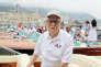 Carlo Riva à bord d'un Aquarama, son modèle légendaire, emblématique de la jet-set méditerranéenne, en juillet 2012, dans le port de Monaco.