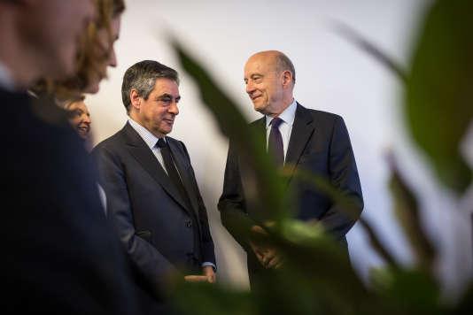 François Fillon et Alain Juppé, lors d'une visite des bureaux de Deezer à Paris, le 19 avril.