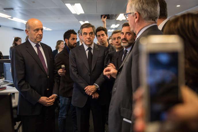 François Fillon et Alain Juppé en visite dans l'entreprise Deezer à Paris, mercredi 19avril, après l'annulation le jour même de celle prévue à l'école42.