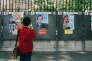 Affiches électorales détournées par l'artiste Combo, à Paris, le 14 avril.
